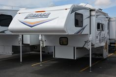 Lance 1052, double-slide, dry bath, truck camper for long bed trucks: http://www.truckcampermagazine.com/camper-reviews/2015-lance-1052-double-slide-review
