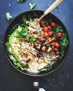 Soba noodles portobello mushrooms with sautéed cherry tomatoes, and drenched in misotahini dressing. Via Anette Velsburg.