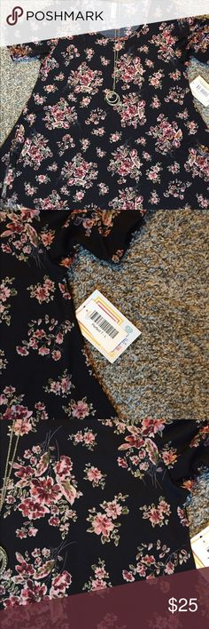 NWT lularoe size large perfect t Lularoe perfect t size large!  nWT!  Dress up with skirt or down with jeans or leggings!  Super cute style flatters all body types!  Size up or down depending on how you like to fit!  I wear size 12 and the large fits super comfy!  This one is a silkier material LuLaRoe Tops