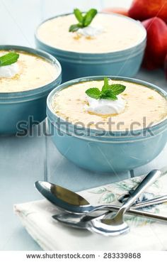 Chilled peach soup with fresh vanilla flavored sour cream. Extreme shallow depth of field with selective on bowl in foreground.