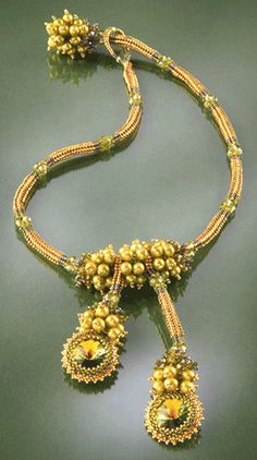 Laura McCabe creates fabulous jewelry. Lots of fun elements.