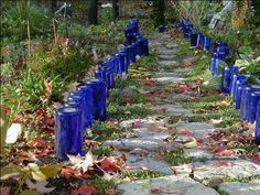 Finally!  I can do this with all the blue beer bottles!  Image detail for -recycled wine bottles | Garden Arts & Crafts
