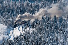 Harz National Park, Germany.  I love the snow colors trees and the train coming around the mountain...