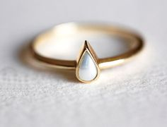 Beautiful & simple pear shaped pearl ring. This is a listing for 14k yellow gold pear shaped pearl ring. This item is handmade . It is a unique piece of jewellery, a perfect present for birthdays, anniversaries, Valentines day, Christmas, weddings, mothers day or simplely a wonderful
