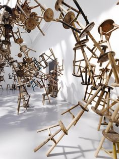 886 three-legged wooden antique stools -  By Ai Weiwei