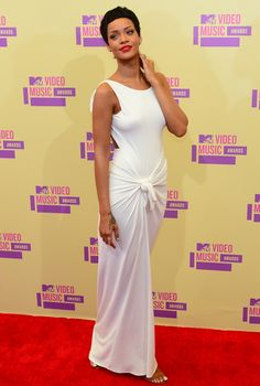 In a Grecian-inspired, draped Adam Selman dress at the MTV Awards in 2012.   - MarieClaire.com