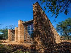 sustainable house, rammed earth and stone walls