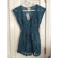 Blue Lace Babydoll Shirt Blue flower lace design. Babydoll style. Short sleeves. V neck. Eyelash Coutore Tops