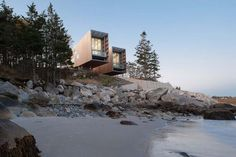 """Two Hulls house in Canada was designed by Mackay-Lyons Sweetapple Architects, who say it's designed as a """"landscape-viewing instrument; like a pair of binoculars, first looking out to sea."""""""