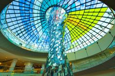 Architectural sculpture of mirrors and coloured glass dome of atrium in extension to Wafi Mall, a modern up market shopping centre