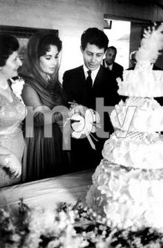 Elizabeth Taylor and Eddie Fisher cut their wedding cake on May 12, 1959 after their wedding in Las Vegas.