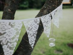 Such delicate bunting! Sam & Tom by Aimee Catt Photography #wedding #english #rustic #lace #bunting #styling #outdoors #decoration