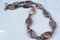 Mixed gemstone faceted with amethyst necklace. $36.00, via Etsy. This necklace is made with faceted flat oval mixed gemstones which measure about 1 x 3/4-in each. The stones have unique patterns and an interesting look to each one. Put together it makes a truly one-of-a-kind piece!!