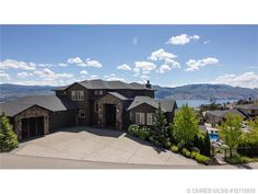 Presented by Quincy Vrecko and Assocaites of RE/MAX Kelowna. Call Quincy at 250-863-8810 to view this amazing home. Perched above Lake Okanagan and the vineyards of West Kelowna, lies this amazing 5300 sq.ft, 5 bedroom home with triple car garage with RV parking and big lake views.