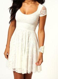 Dámské krajkové šaty v bílé nebo mentolové barvě.