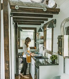 Yes, you can touch both walls when standing at the sink, but you can also store and prep a multiple-course meal for a (small) crowd, thanks to a 24-inch under-counter fridge, a 20-inch four-burner gas range, and ample granite counter space.