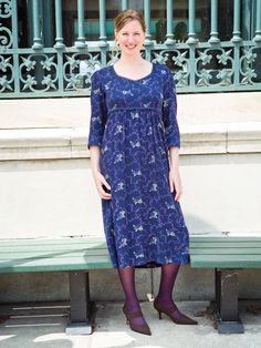 The Angelina dress in navy is lovely for a night out and is the perfect complement for a lady   any day. The elegant renaissance collar is trimmed with our fine crochet lace and the elegant empire waist is framed with a gorgeous tapestry cord. Garment is tea length and sports a comfortable three-quarter sleeve.