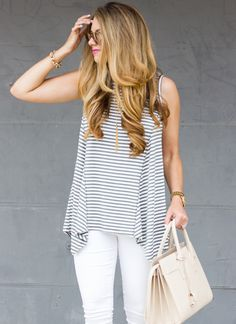 Pair a striped tank with white denim and a neutral bag for a fresh and airy summer feel.