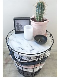 Kmart metal basket transformed into a side table!
