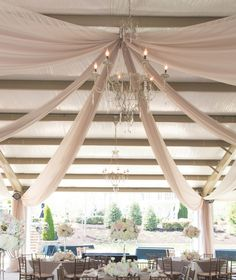 Crystal chandelier for romantic wedding. See more Knoxville wedding inspiration with sheer drapery for your venue by All Occasions Party Rentals! | The Pink Bride www.thepinkbride.com