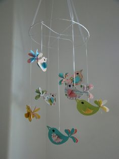 Paper Bird Baby Mobile w/ acrylic spray to preserve life of paper.  Would do this with a boy theme :)