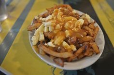 Who doesn't love a tasty poutine from Montreal?! :) http://thetasteoftravel.com/food/poutine-daily-food-photo/