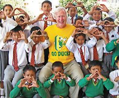 """Jeff Clark '70 with other Nepalese children, forming Os with their hands, at an orphanage in Kathmandu, Nepal."""" #nationalbrand"""