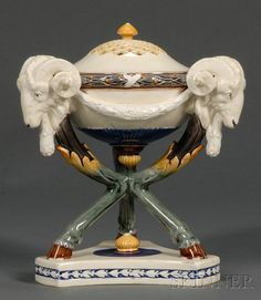 Wedgwood  Majolica Tripod Incense Burner and Cover, England, c. 1872, domed and pierced lid, the bowl mounted with three goat heads and set on hoofed feet on a triangular base, impressed mark, ht. 8 3/4 in.  |  SOLD $1,300
