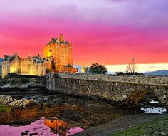 Vibrant sunset over the famous Eilean Donan Castle, Scotland | 19 Reasons Why Scotland Must Be on Your Bucket List. Amazing no. #12