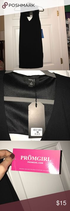 Black open back shift dress Brand new with tags and never worn. This dress has a v cut in the front and a triangle cut out in the back. Very J Dresses Midi