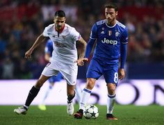 """Claudio Marchisio of Juventus (R) being followed by Victor Machin Perez """"Vitolo"""" of Sevilla FC (L) during the UEFA Champions League match between Sevilla FC and Juventus at Estadio Ramon Sanchez Pizjuan on November 22, 2016 in Seville, ."""