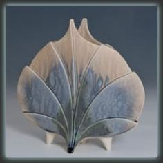 "Newman Ceramic Works - Standing Leaf Vase Shown here is the Standing Leaf Vase from Newman Ceramic Works. It's gorgeous Sandstone Blue glaze makes this piece really stand out. Measures 8"" H x 8.75"" W"
