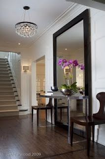 Large Mirror behind console table, in foyer