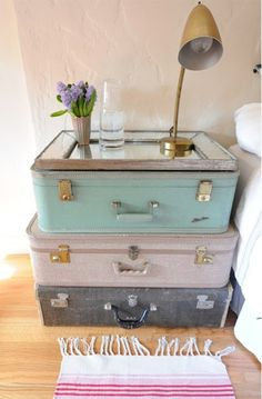 good idea: old suitcases topped with a framed mirror create a quirky bedside table