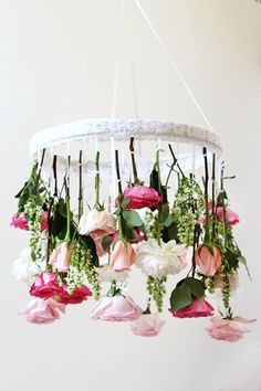 DIY Floral Chandelier for a Fun and Modern Bridal Shower | HonestlyWTF | See More! http://heyweddinglady.com/fabulous-fuchsia-bridal-shower-inspiration-wedding-paper-divas/