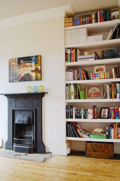 for living room--i like the unique fireplace, the casual shelving. make them floating shelves, on either side, in maybe a distressed wood.