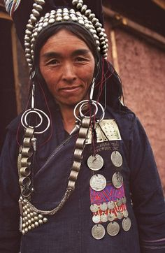 North Laos | A colorful woman from the Ikor Tribe, sub group of the Akha ingenous group. It is interesting to see how they decorate themselves with the old French & soviet coins. Phongsali province. | ©BoazImages