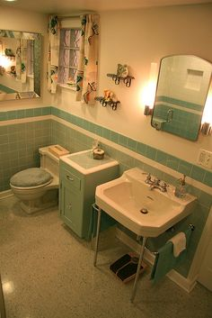 Gorgeous blue tile bathroom vintage style from scratch! is part of Vintage bathrooms - Nanette and Jim created a gorgeous vintage bathroom from scratch They used Daltile from Home Depot, glass block, salvage sink Read all their resources Bad Inspiration, Bathroom Inspiration, Regal Design, Bathroom Tile Designs, Bathroom Colors, Aqua Bathroom, 1950s Bathroom, Granite Bathroom, Shower Designs