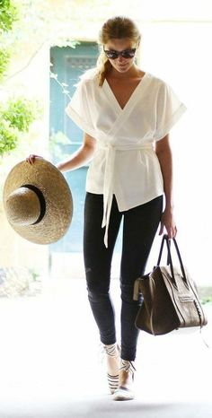 easy, breezy wrap top, jeans, espadrilles, sun hat, sunglasses, and a carryon bag fit for the long haul