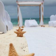 Stunning, turquoise & sand coloured destination wedding in Mexico.& I LOVE the starfish aisle decor ~ so simple & chic!