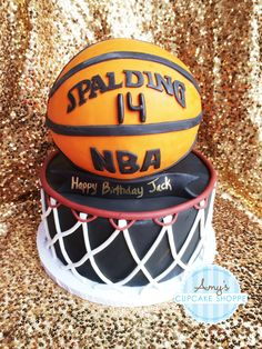 3-D basketball 14th birthday boy cake. Vanilla bean cake filled and frosted with vanilla buttercream with fondant basketball net decor. Sphere chocolate basketball cake with fondant decor.