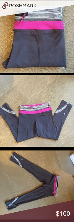 NWOT Lululemon cropped pants NWOT Lululemon cropped grey pink pants with a pink waist.  Zipper pocket on the back waist. . Bottoms are fitted with a stripe pattern as well. I bought these and took the tag off but never wore them- they are too small for me. I wish they fit- I would love to keep them!  Smoke free home. Please feel free to ask any questions. lululemon athletica Pants Ankle & Cropped