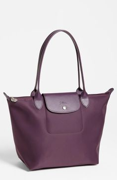 Purple handbag staple: Longchamp Tote. I want one in blue!