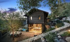 The house, currently listed for sale, is tucked amidst the trees of the iconic Uplifters Ranch neighborhood of Rustic Canyon, and offers privacy to its occupants.