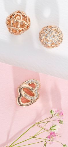 Charming PANDORA rose charms are the perfect add-on for your day to night look.