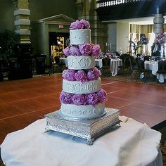 white cake with peonies between each layer
