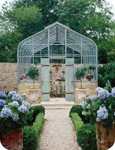 What a lovely greenhouse, or outside tea room
