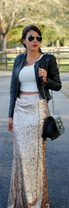 NOT! Where is she going? To Ruby Tuesdays for a drink and nachos or to the Opera, an Opening Gala? Her upper half is hungry, her lower half wants an Evening To Remember, LOL! My opinion, a Street Style Strike OUT!                            Shining gold sequin maxi skirt / TheChiffonDiary