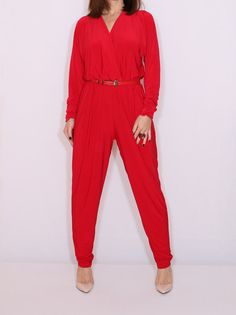 MEDIUM | Batwing jumpsuit for women in Bright red color.  Top of this jumpsuit designed with batwing sleeve which has elastic on cuffs, top has soft draping to the waist, harem pants cut and elastic band on the waist. Also, jumpsuit has two pockets. ______  Fabric : lycra/spandex blend. _______ Also