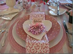 Table setting in carnation pink with heart shaped plate.